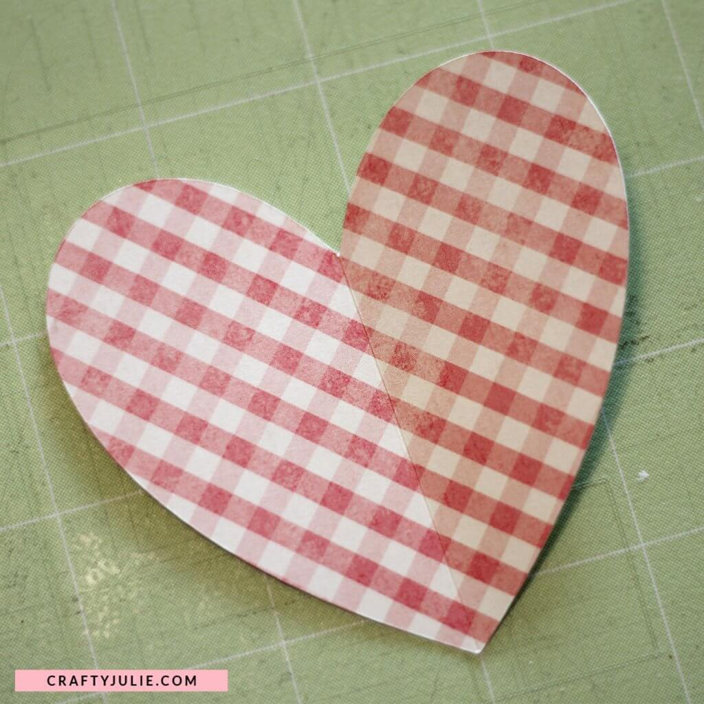heart shape cut out from pink plaid cardstock with score line down the middle using Cricut Explore Air 2