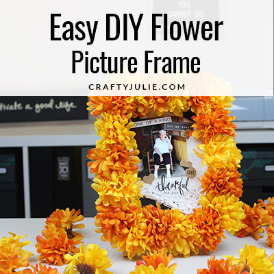 Learn to make an easy DIY flower picture frame inspired by Dias De Los Muertos with orange and yellow flowers