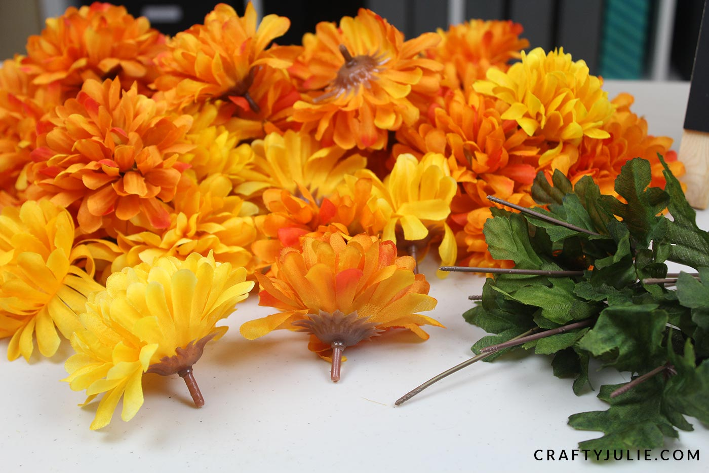 orange and yellow fake flowers with bud tips attached